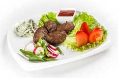 Kebab with vegetable and greens. On white plate Royalty Free Stock Photo