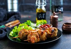 Kebab. And vegetable salad on plate., fried meat stock images