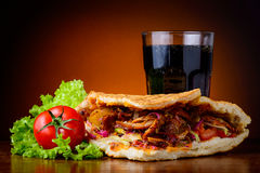 Kebab, vegetables and cola drink Stock Photography