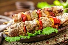 Kebab. With vegetables on a plate. Shashlik royalty free stock photos