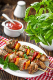 Kebab. With vegetables on a skewers on plate Royalty Free Stock Image