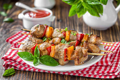 Kebab. With vegetables on a skewers on plate Royalty Free Stock Photo