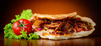Kebab and vegetables Stock Images