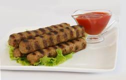 Kebabche e ketchup Fotografia Stock Libera da Diritti