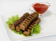 Kebabcheta y salsa de tomate Imagenes de archivo