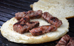 Kebabs on a  bread on grill Stock Photos