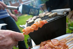 Kebabs and burgers on the grill for barbecue Stock Photos