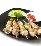 Kebabs of chicken. Skewers of chicken on a plate Stock Photo