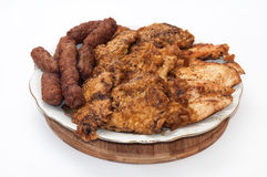 Kebabs, chicken and pork fried meat served on a plate Stock Photos