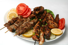 Kebabs and chicken wings Royalty Free Stock Photography