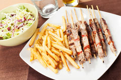 Kebabs with chips Stock Photos