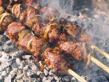 Kebabs cooking on the gril Stock Photo