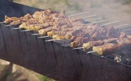 Kebabs are fried on the grill in the open air stock photography