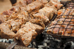 Kebabs on the grill. Kebabs cooking on the grill Stock Photography