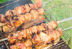 Kebabs grilled skewers on the street. Fresh kebabs on skewers grilled over charcoal on the street Stock Photo
