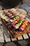 Kebabs ready to cook on a barbacue Stock Images