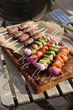 Kebabs ready to cook on a barbacue Royalty Free Stock Images