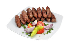 Kebabs with salad. On white table Royalty Free Stock Photos