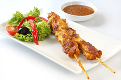 Kebabs and Salad. Chicken kebabs and salad.  Skewed satay chicken, with satay sauce Stock Photography