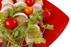 Kebabs served on red plate Royalty Free Stock Photos