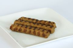 Kebapche. Is ground minced meat with spices, a cylindrical shape and grilled. It is typical for the Bulgarian and Serbian cuisine. Traditionally tata be Royalty Free Stock Image