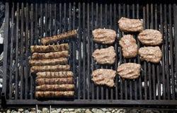 Chopped meat kebapcheta, meatballs, charcoal grill. Kebapcheta and meatballs on charcoal grill Stock Image
