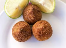 Kebbe. Three small pieces of kebbe, a lebanese dish with mince meat or mushrooms and lemon as viewed from the top. Delicious food Royalty Free Stock Photos