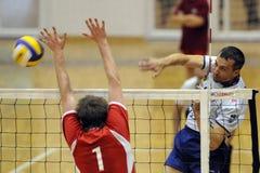 Kecskemet - Kaposvar volleyball game. KECSKEMET, HUNGARY - APRIL 27: Sandor Kantor (R) strikes the ball at a Hungarian National Championship Final volleyball stock images