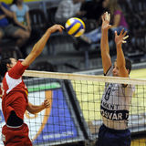 Kecskemet - Kaposvar volleyball game. KECSKEMET, HUNGARY - APRIL 27: Bagics (L) and Schulcz (R) in action at a Hungarian National Championship Final volleyball Royalty Free Stock Photography