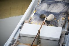 Inside boat with fishing net stock photography