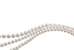 Kedja av vita pärlor Arkivfoto