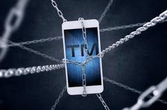 Kedjad fast smartphone med varumärkessymbol Fotografering för Bildbyråer