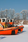Keelboats on the frozen river Stock Photography
