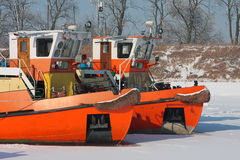 Keelboats on the frozen river Stock Images