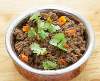 Keema minced beef curry. A minced beef or keema curry in a serving bowl, garnished with coriander leaves Royalty Free Stock Photo