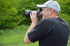 Keen photographer. Men outdoor stock photo