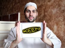 Keen shoe company logo. Logo of Keen shoe company on samsung tablet holded by arab muslim man. KEEN is an American footwear and accessories manufacturing company stock photo