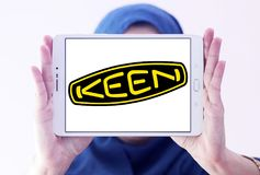 Keen shoe company logo. Logo of Keen shoe company on samsung tablet holded by arab muslim woman. KEEN is an American footwear and accessories manufacturing royalty free stock photo