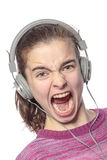 Keen shouting female teenager with headphones Stock Image