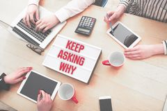 Keep asking why in small business team background stock images