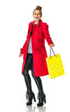 Smiling trendy woman on white with yellow shopping bag Stock Photo