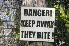 Keep away they bite stock image