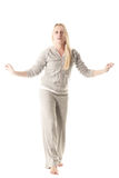 Keep balance. Blonde girl in grey sportswear keeping balance isolated Royalty Free Stock Image