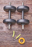 Keep balance with dumbbells. Pair of dumbbells and expanders, top view Royalty Free Stock Images
