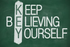 Keep believing yourself. Acronym of KEY. Believe in yourself written in chalk on a blackboard Royalty Free Stock Images
