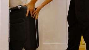 Keep the black suitcases into the wardrobe Stock Images