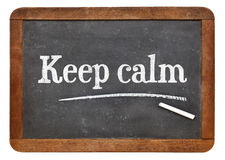Keep calm advice or reminder on blackboard Royalty Free Stock Photos