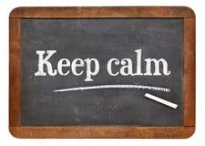 Keep calm advice or reminder on blackboard Royalty Free Stock Photos