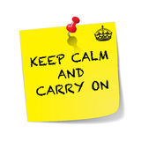 Keep Calm And Carry On Sticky Note With Pin. A yellow sticky note with a red pin  saying keep calm and carry on isolated on a white background Stock Photo