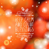 Keep calm and count blessings - typographic. Keep calm and count blessings. Hand sketched graphic vector element with acorns and text on blurred background Stock Photo